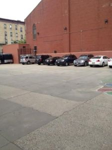 Schoolyard with cars May 2015